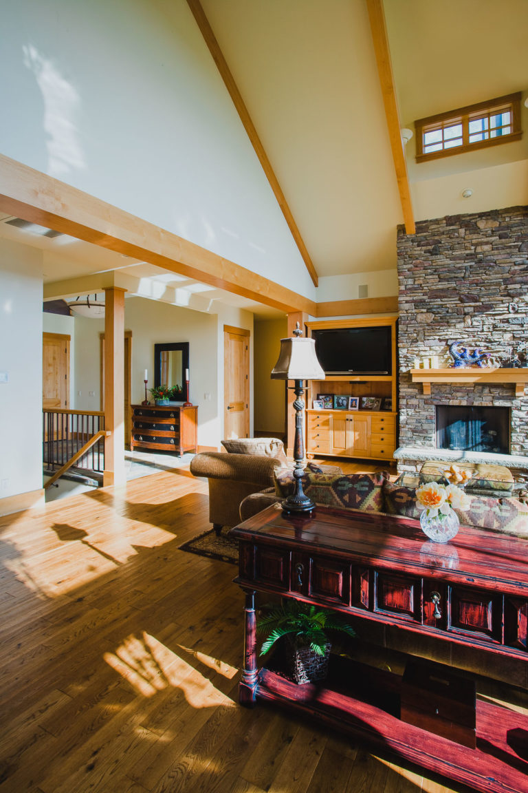 ceiling beams, stone fireplace, entertainment center