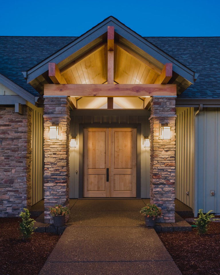 entry porch, wood ceiling, Cultured Stone columns, exterior lighting, entry door