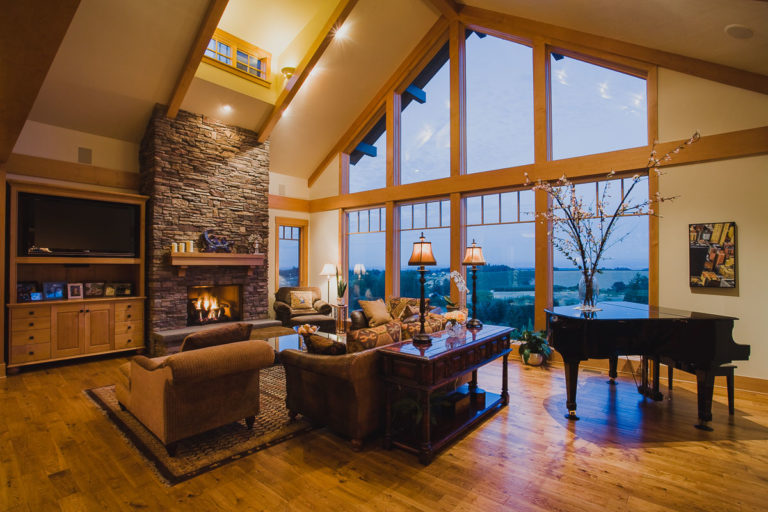 entertainment center, stone fireplace, wood mantel, picture window, piano, lighting, dormer
