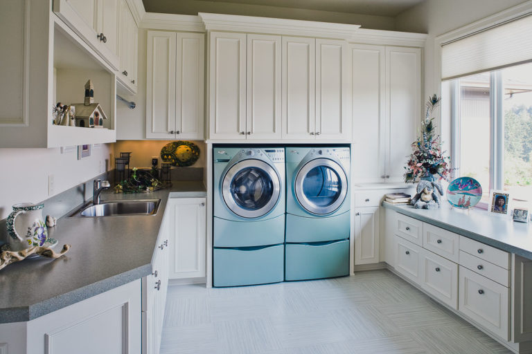 laundry, appliances, Amtico vinyl floor, plastic laminate counter, cabinets, utility sink
