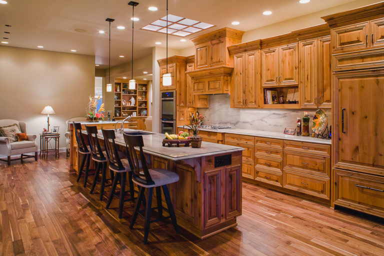 Kitchen, cabinets, granite counter, pendant lighting, walnut hardwood flooring, granite splash, skylight grid, recessed lighting, appliances