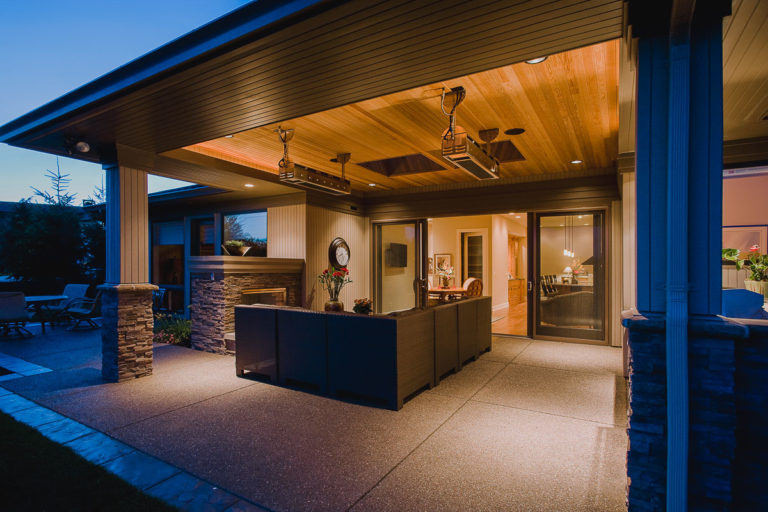 Covered patio, exposed aggregate concrete, outdoor heater, fireplace, T&G cedar ceiling, Andersen patio door
