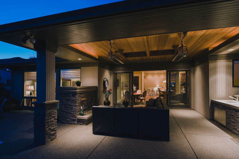 Covered patio, outdoor fireplace, outdoor kitchen, heater, exposed aggregate concrete, Andersen patio door