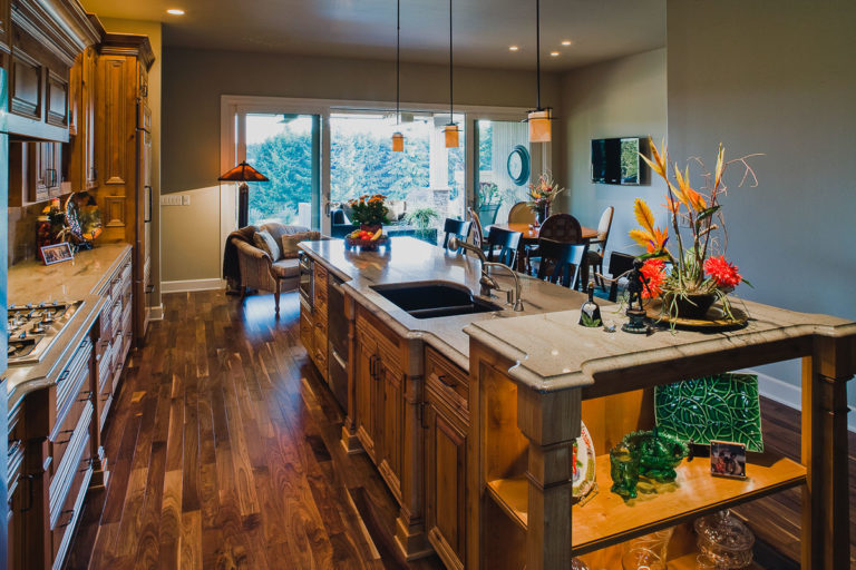 Kitchen, cabinet, walnut hardwood floor, granite counter, accent lighting, pendant lighting, Andersen patio door