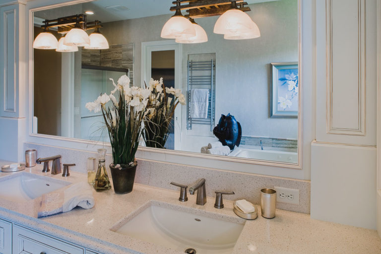Master bath, mirror, quartz counter, lighting
