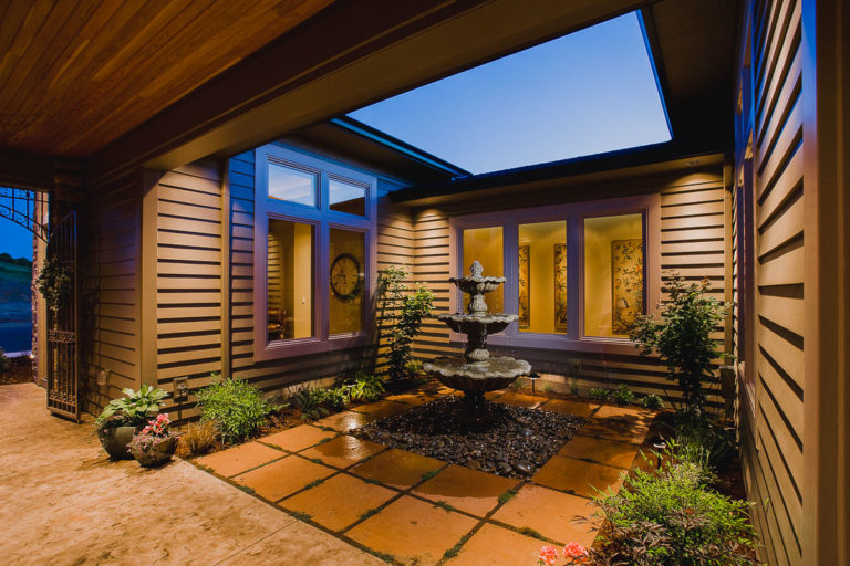 courtyard, fountain, stamped concrete, Artisan hardiplank siding, Milgard casement window, iron gate, cedar ceiling